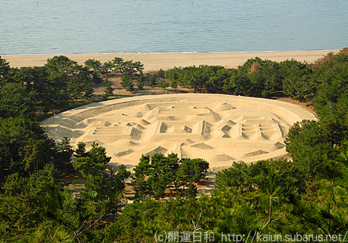 Ariake beach of coins sand art